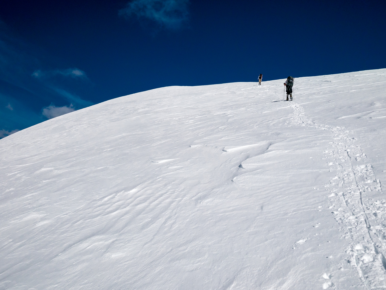 Back on reasonable terrain - feels flat after the face! Almost at the summit - watch out for cornices on the right.