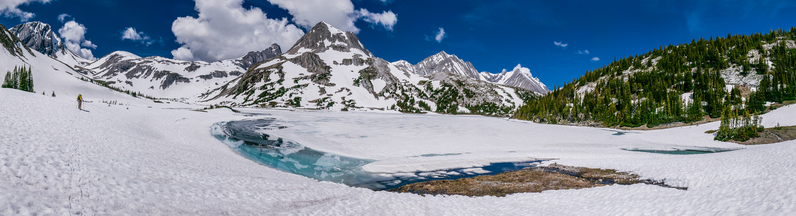 Aster Lake is still covered in ice - but with a beautifully colored ring of water around its edges.