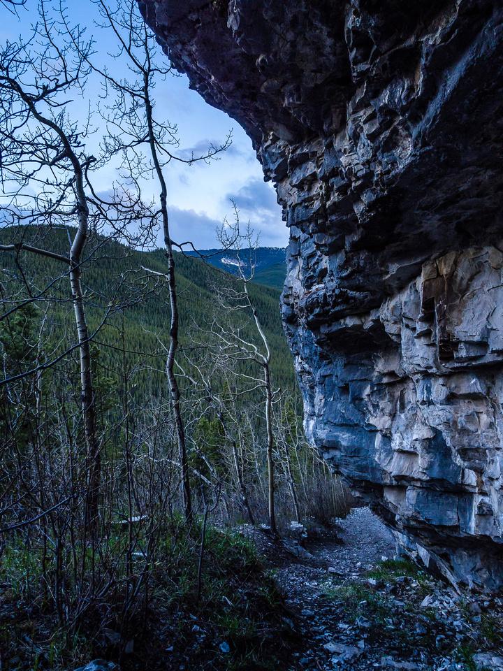 Traversing under the White Buddha cliffs.