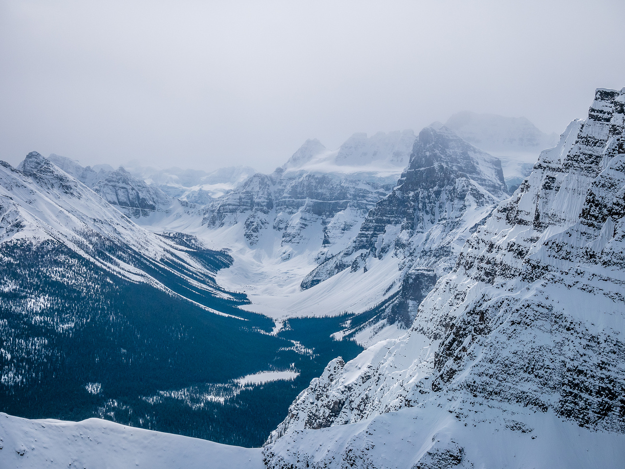 Looking into the Consolation Lakes area over the east ridge of Mount Temple. Panorama Ridge at left and Tower of Babel at right.