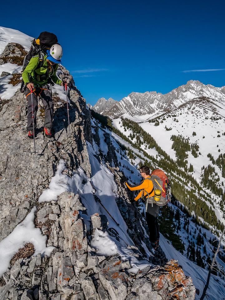 Steven assists Kev as he regains the ridge.
