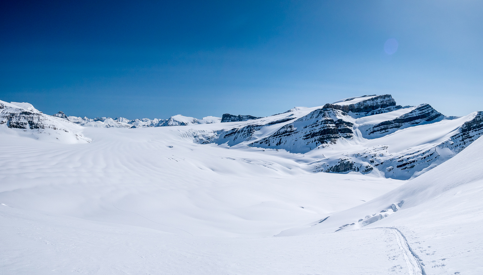 A gorgeous day to be in the mountains, looking back - can't wait to ski this on the way down!