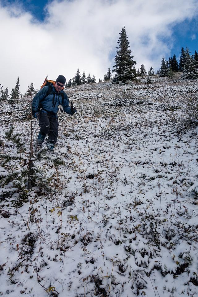 Descending slick grassy slopes.