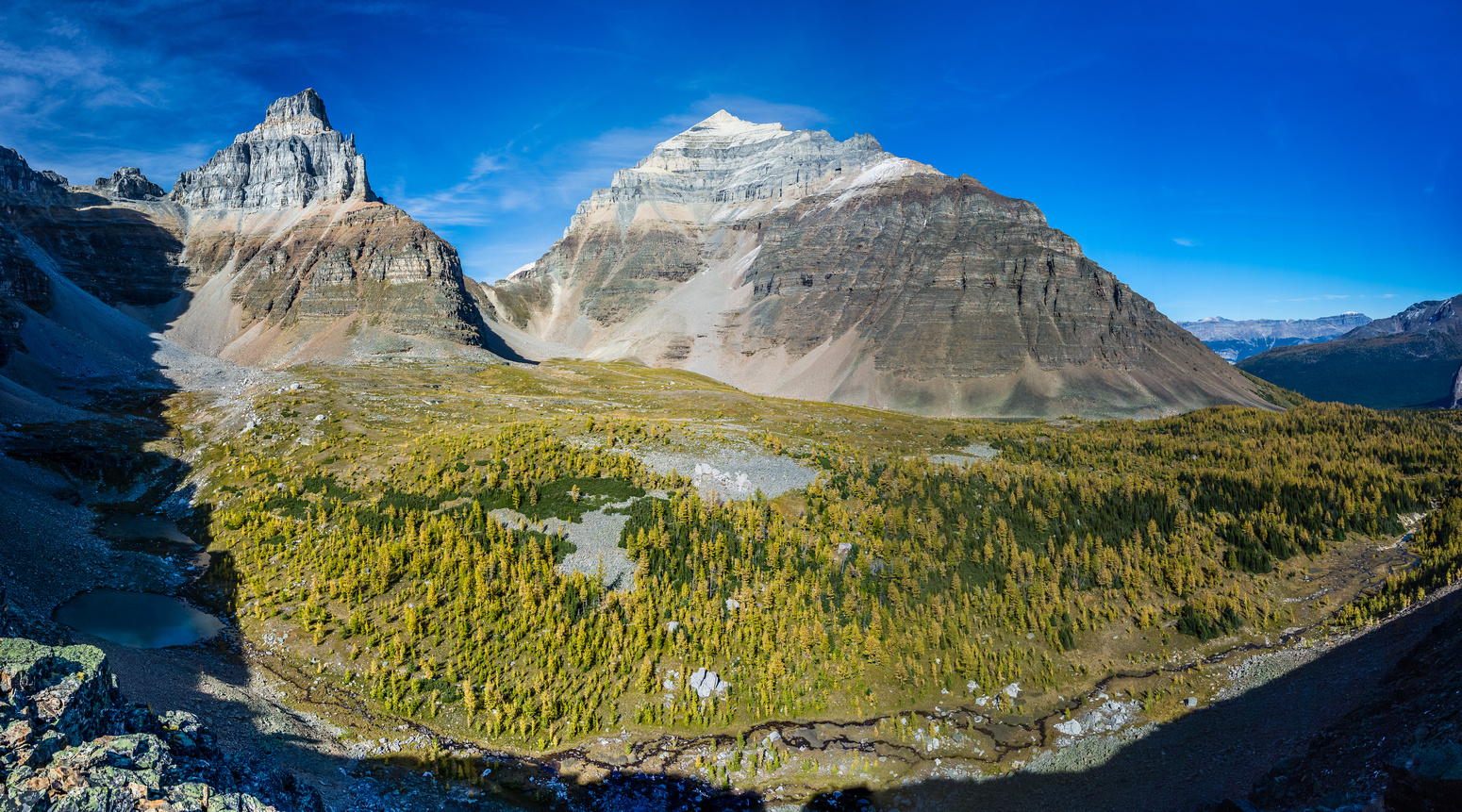Great views of Larch Valley with Pinnacle (L) and Mount Temple (R) looming above.