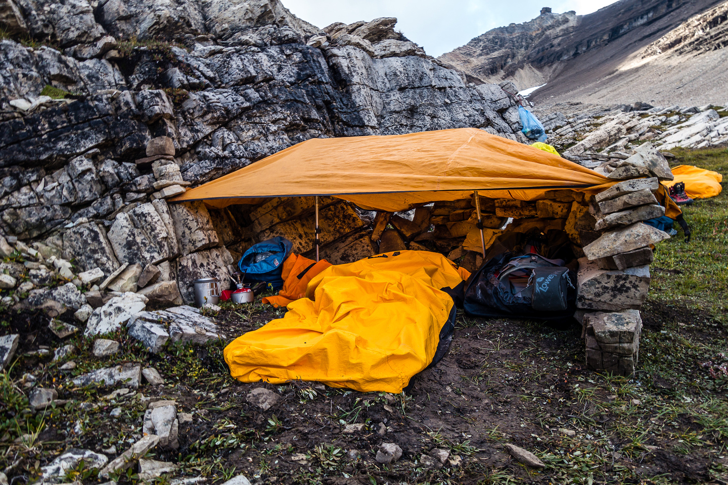 My setup for the bivy. Kept me dry through a LOT of rain! Rocks and trekking poles are critical to making this shelter work.