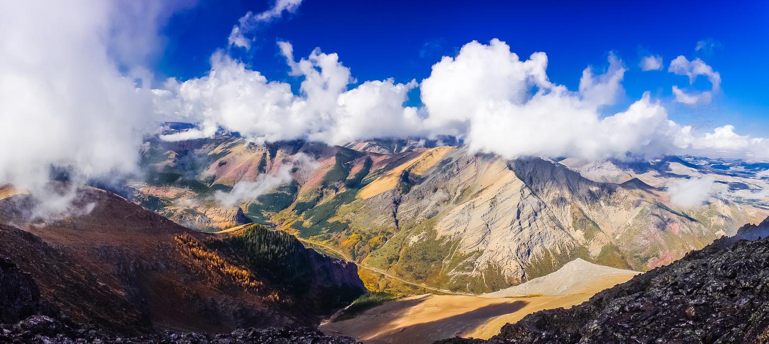 Pincher Ridge is across Drywood Creek to the NE. Victoria Peak and Ridge are hidden in cloud beyond.