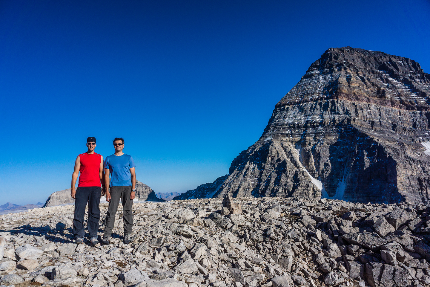 Vern and Kev on the summit of Strom with Assiniboine looming over 600 meters (2000 feet) above us.