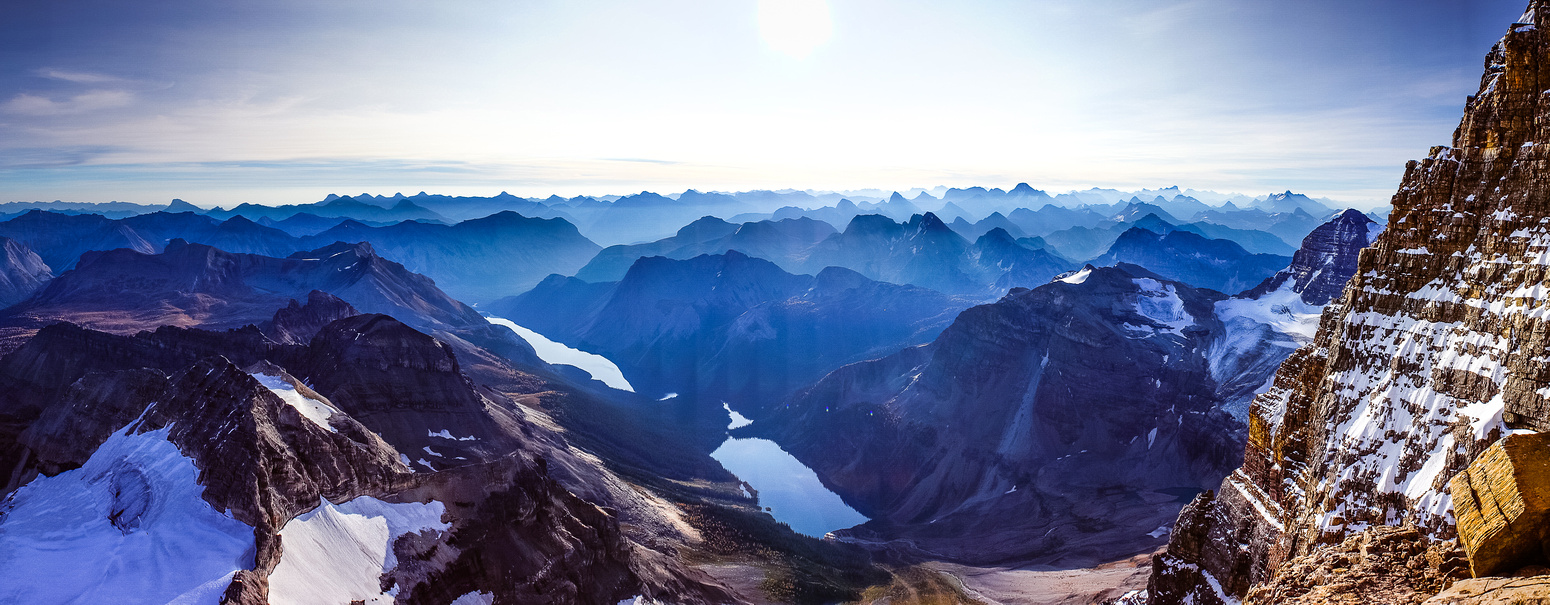 Spectacular views across the east face. Lakes Gloria and Marvel on the bottom left. Forest fire smoke from the USA lingers over the ocean of peaks in the distance.
