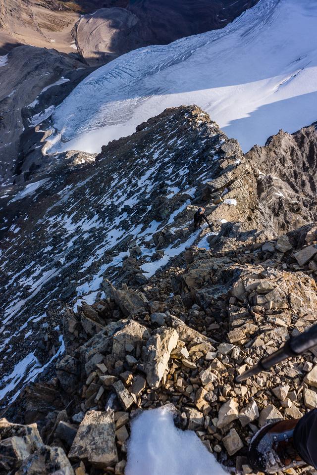 Kev climbs the north ridge of Assiniboine.
