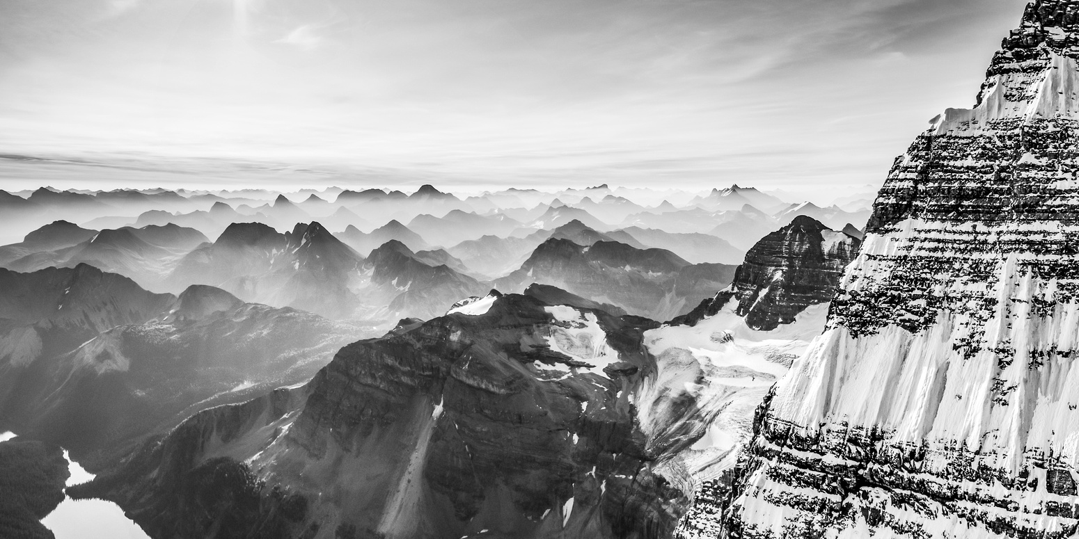 One of my favorite pano's from all my climbs - looking across the east face / ridge of Assiniboine at a smoky morning sunrise.