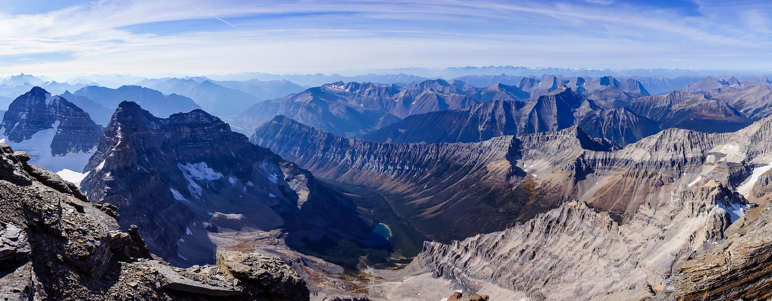 Great view down the SW face, looking at a very distant Lunette Lake and our exit valley.