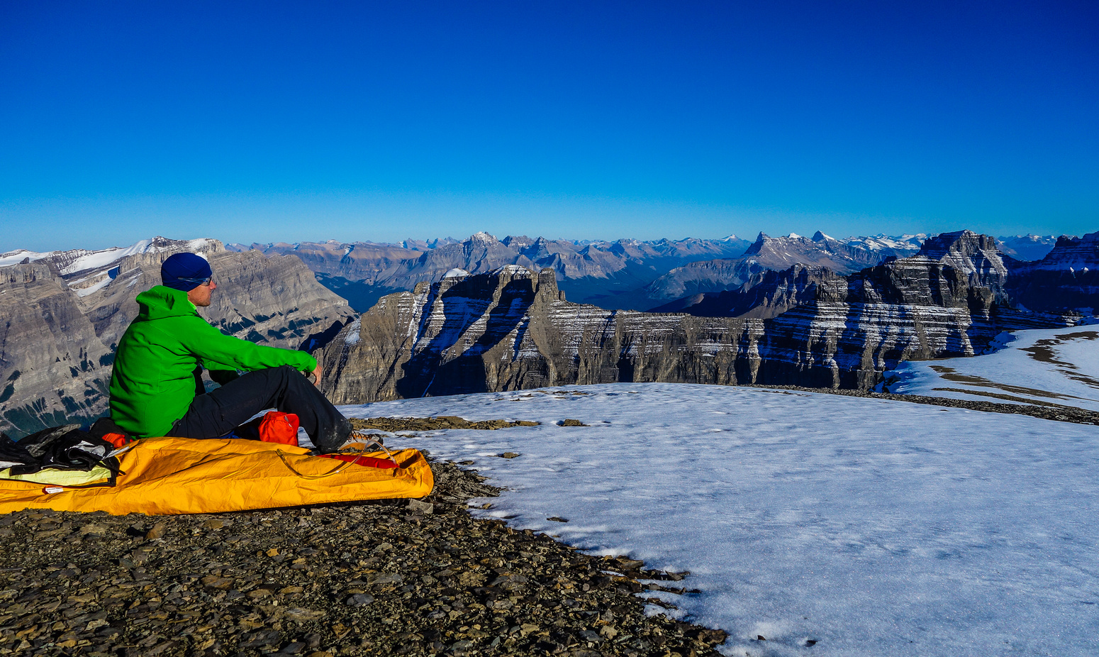 Vern takes in the awesome views from his bivy site. Murchison, Wilson, Sarbach, Chephren, White Pyramid, Howse and Erasmus