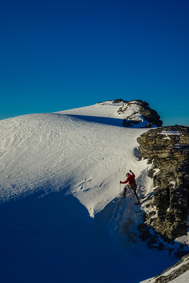 Eric makes his way onto the Monchy icefield from the descent ridge of Amery.
