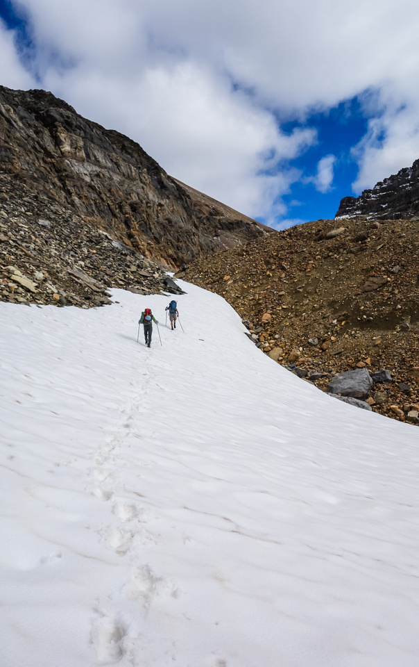Using snow patches to gain height to the headwall guarding Iceberg Lake.