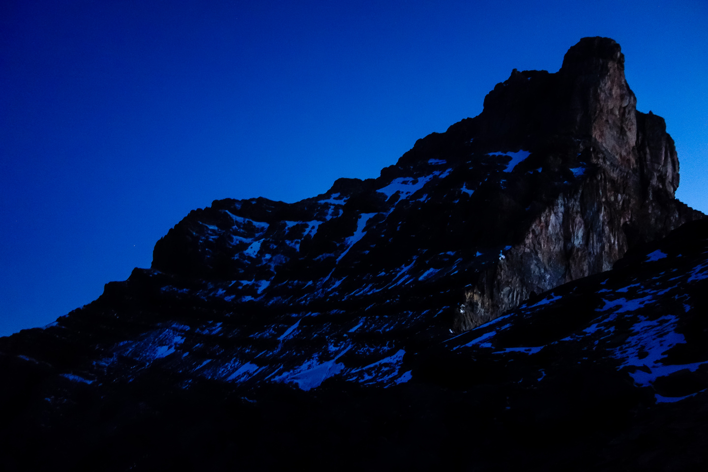 The SW face of Fryatt looms ominously in the pre-dawn dark as we gain height to the 9900' col.