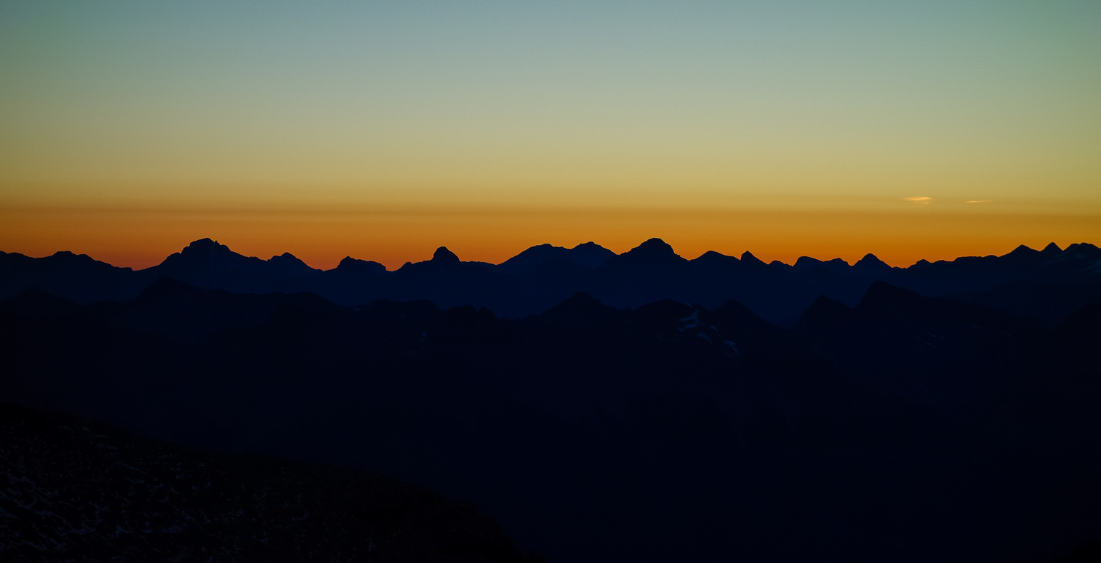 A gorgeous sunrise to the east as we pop onto the 9900' col.