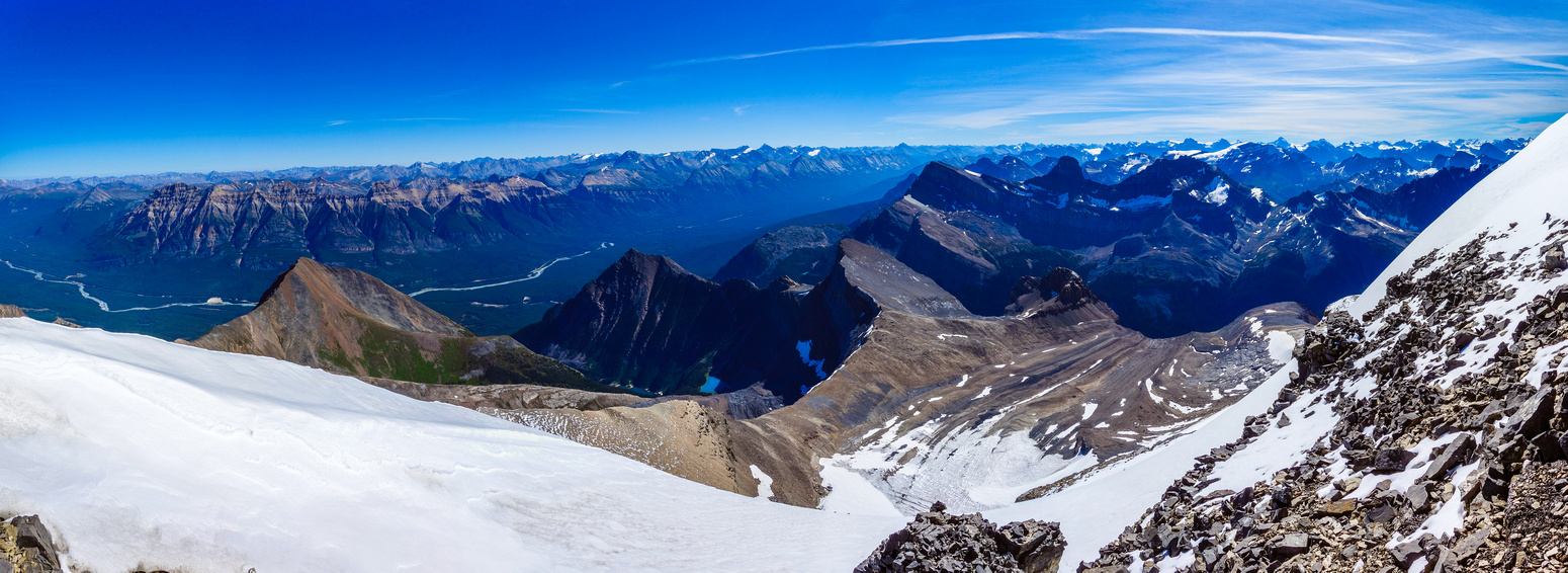 Looking southeast over Kerkeslin (L). Many familiar peaks around the Columbia Icefields to the right, including Alberta, Woolley and Diadem.