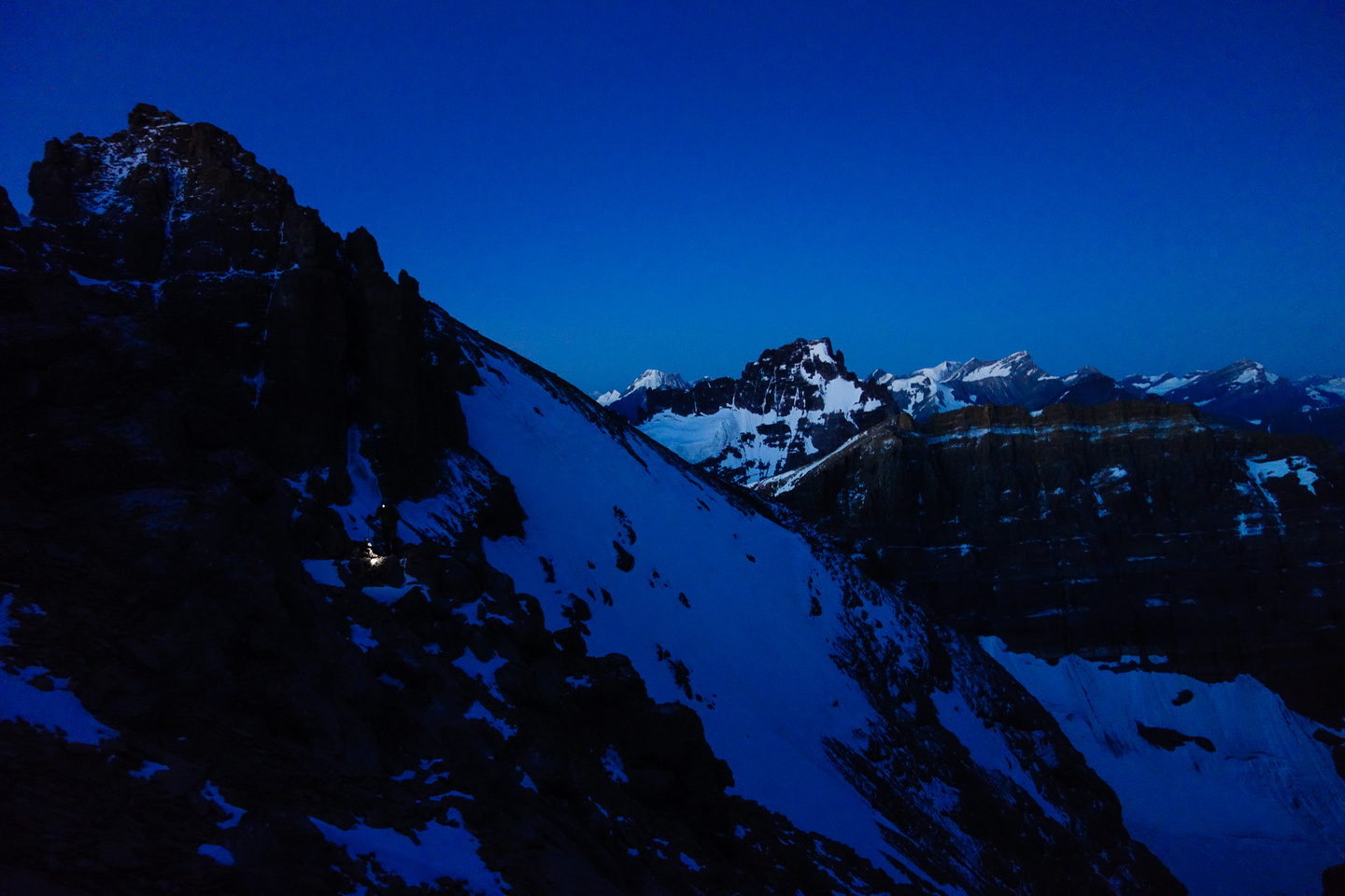 It's still very dark as we make our way up the first scree slope.