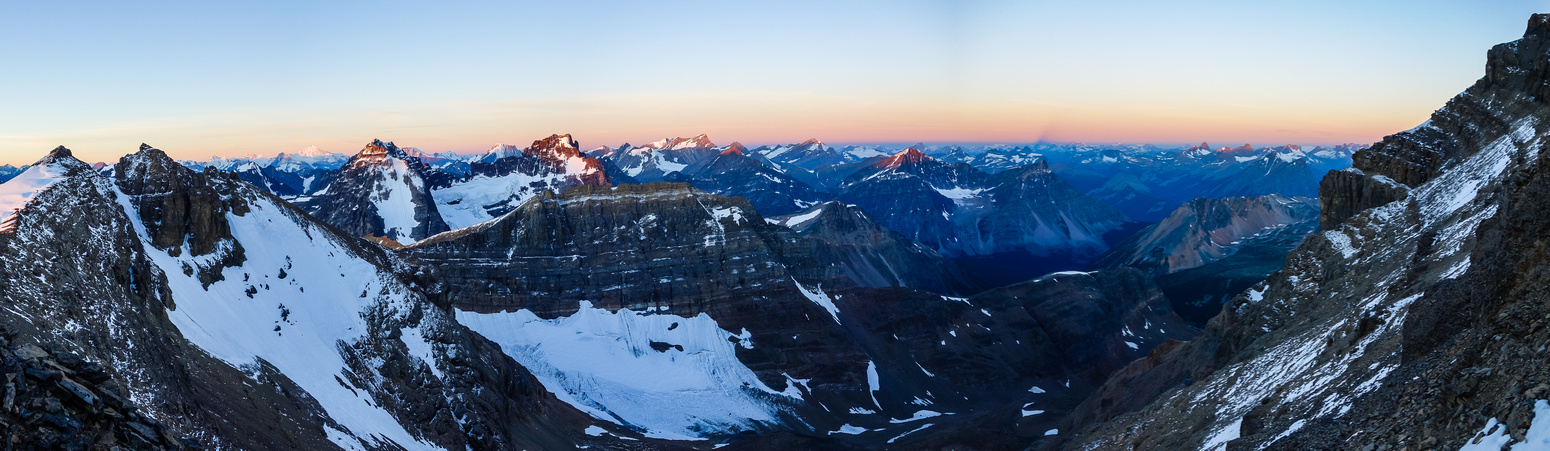 The sun finally rises on the surrounding peaks - notably peak 9900' on the left, with Belanger and Lapensee catching alpine glow over Fat Bastard.
