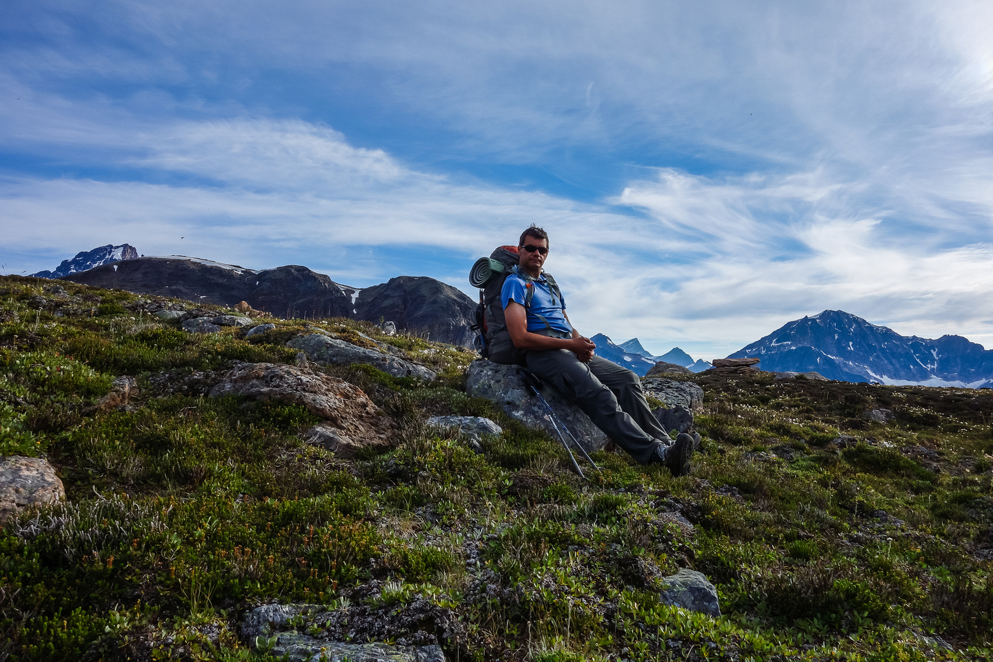 A very satisfied Kevin Barton takes a well-deserved rest break in the alpine meadows above the Geraldine Lakes.