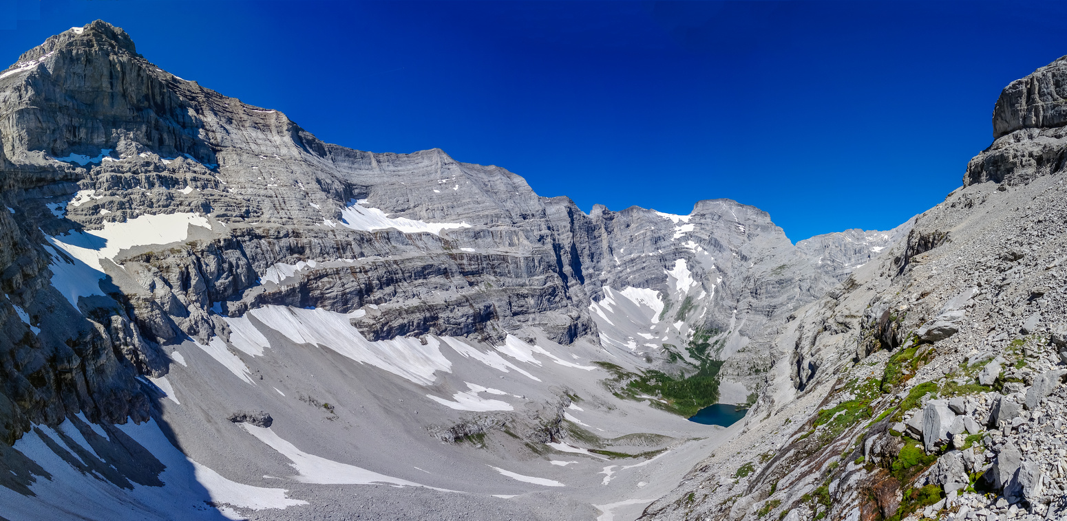 Part way through the cliff band, the third memorial lake is just visible. Mount Bogart at upper left.