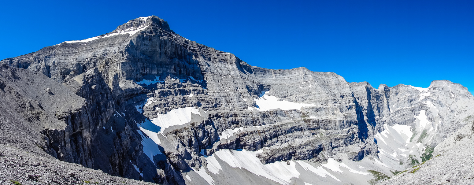A panorama from the top of the cliff band looking back at Mount Bogart (L) and Sparrowhawk (R).