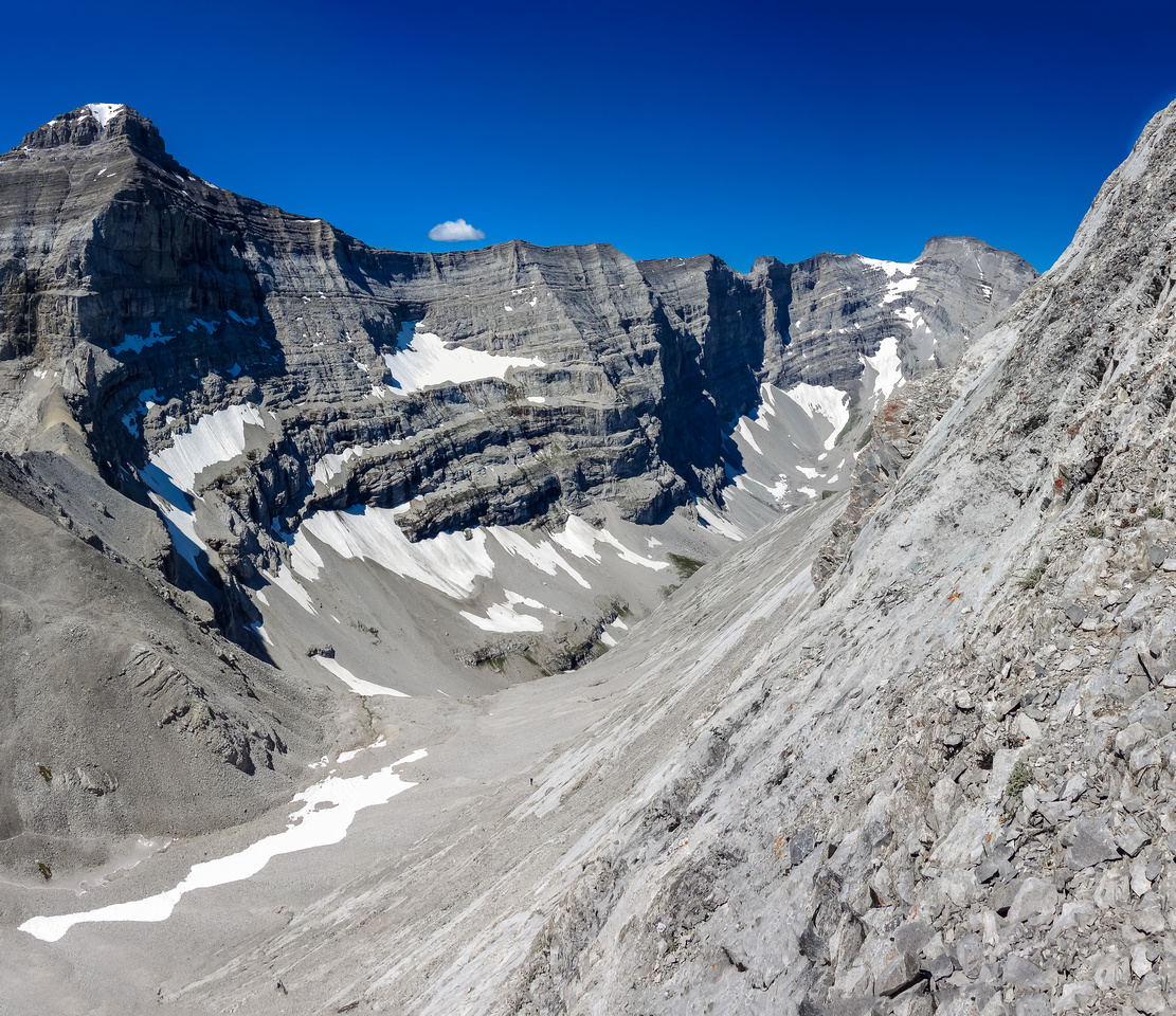 Impressive slab terrain, looking back from where I hit the south ridge. Sonny barely visible at the bottom of the slab.