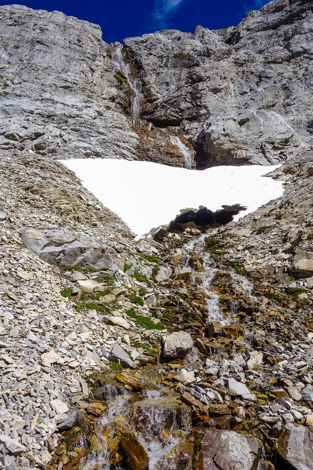 The lovely waterfall coming down the headwall is a relief in the unrelenting heat.