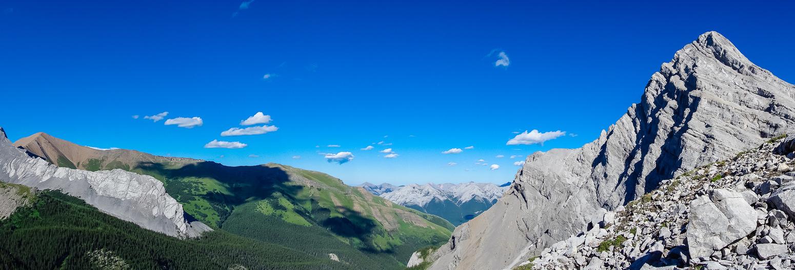 Great views of Mount Allan's green ridge and Ribbon Peak's curved summit.