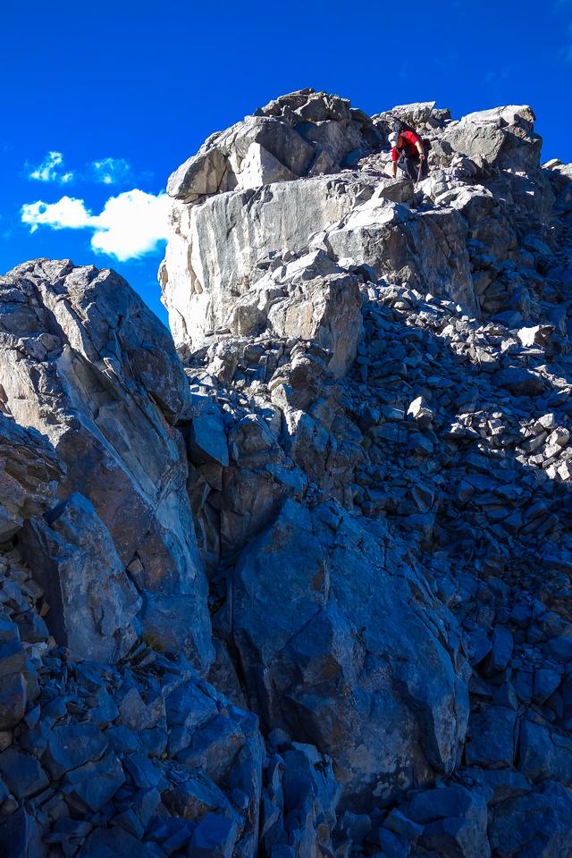 Sonny descends the loose ridge of Bogart Tower.