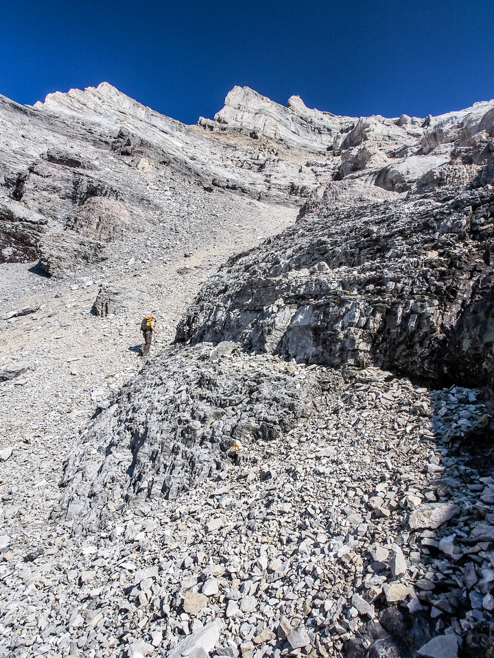 Wietse searches for the trail that eventually goes climber's right to gain the upper ridge.