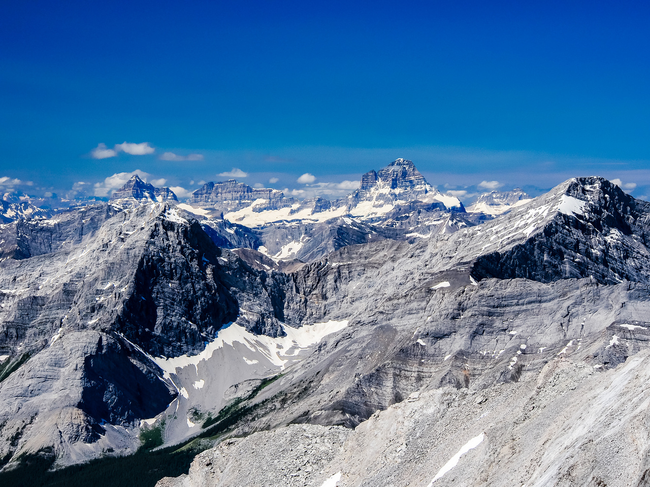 Summit views over Nestor (L) and Old Goat (R) to Assiniboine, Eon and Aye.