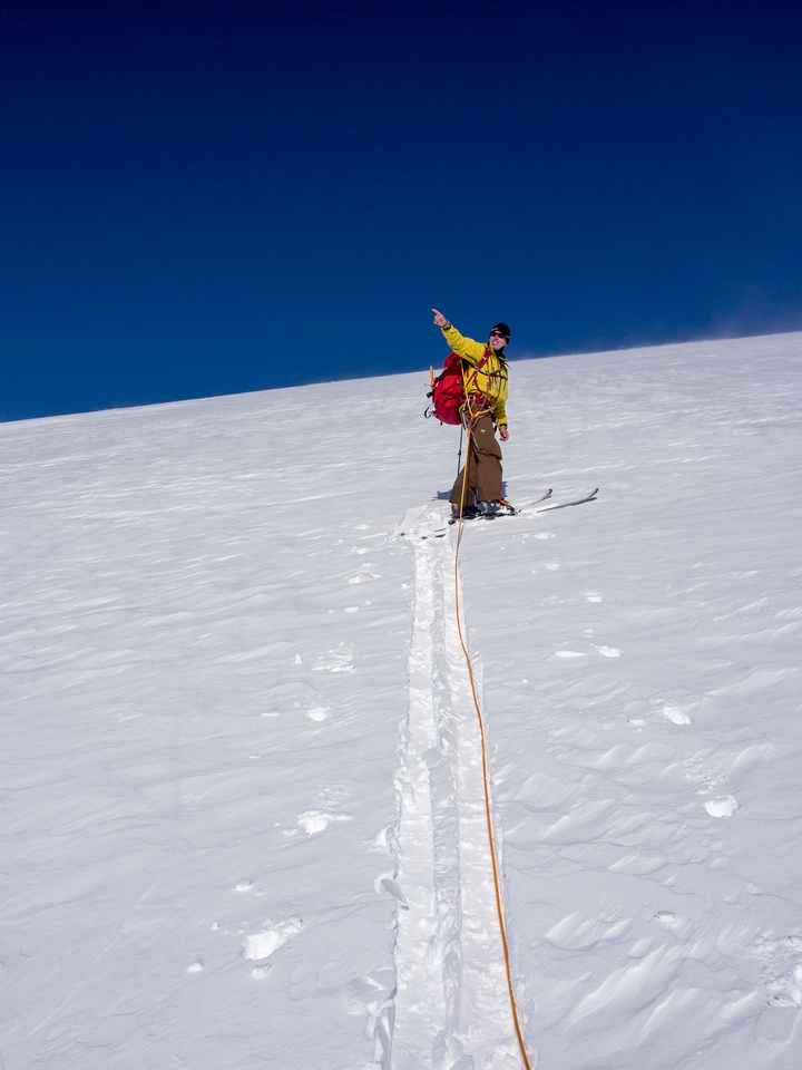 TJ points out his next objectives as we take a break on the way up the south ridge.