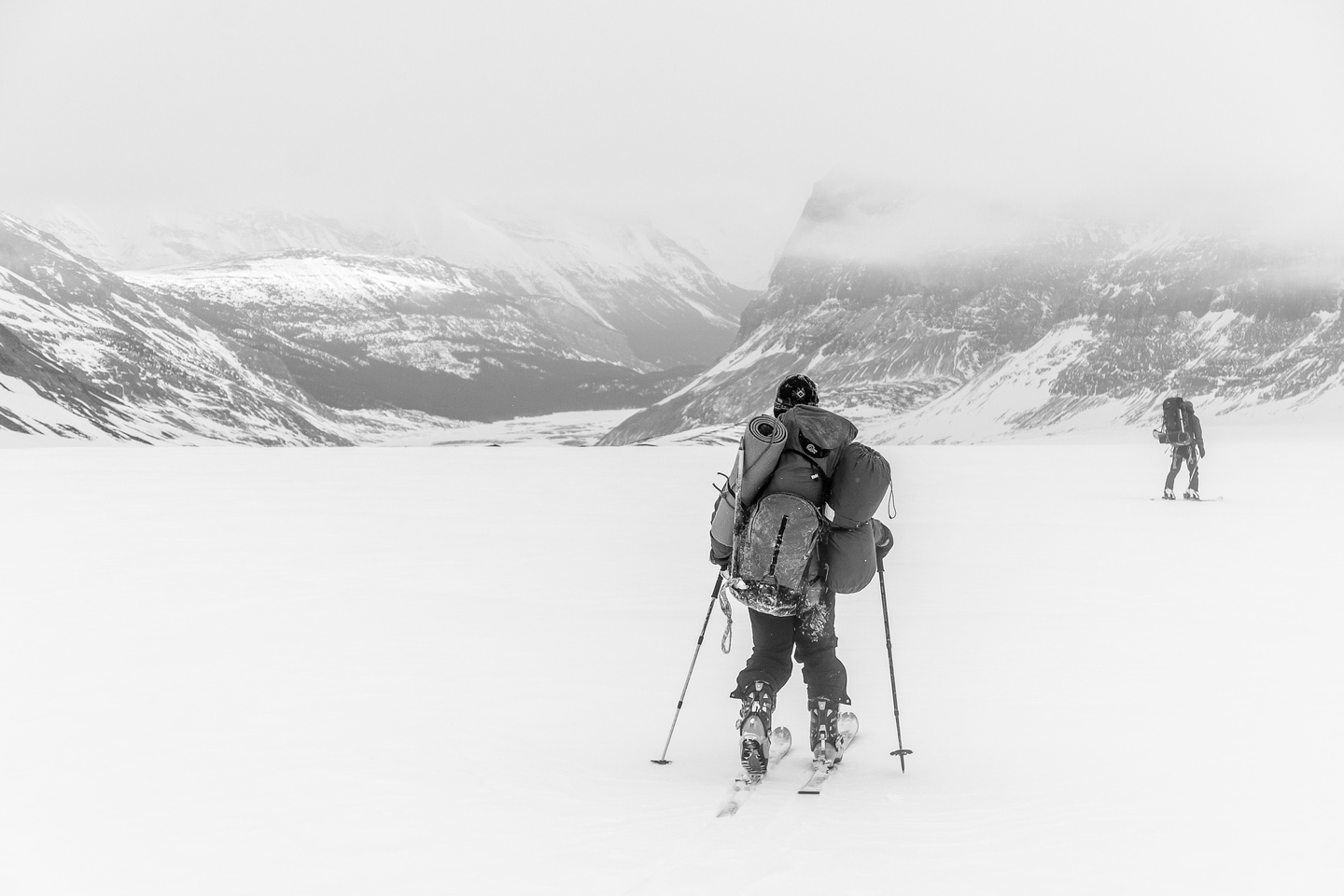 Slowly skiing under the cloud cap.