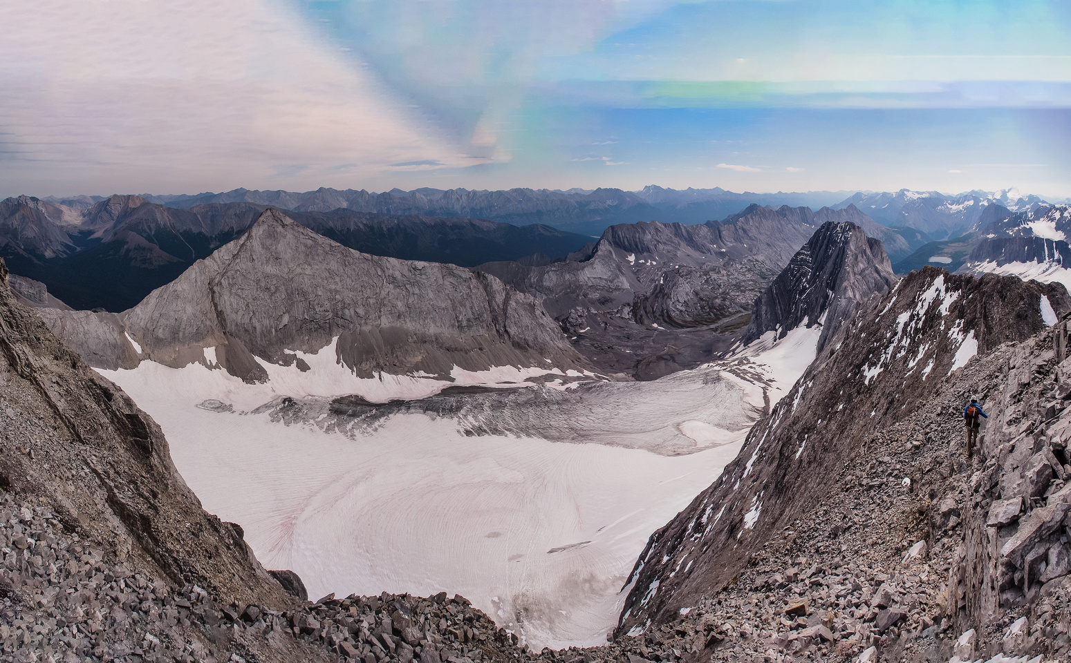 Traversing off the ridge to the north with nice views of Mount Smith Dorrien.