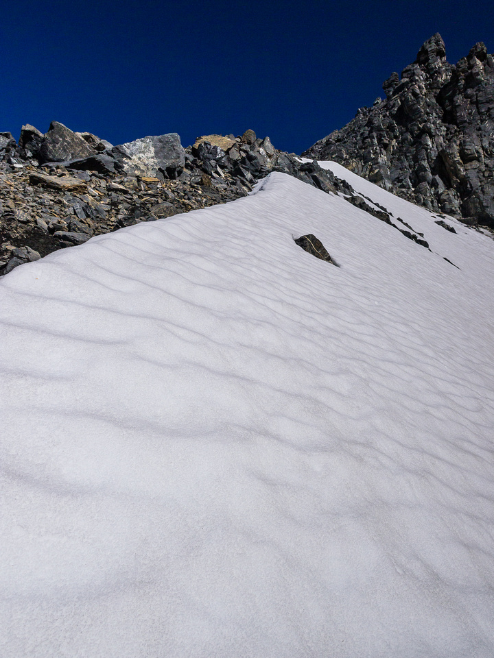 Avoiding scree and slabs by taking snow.
