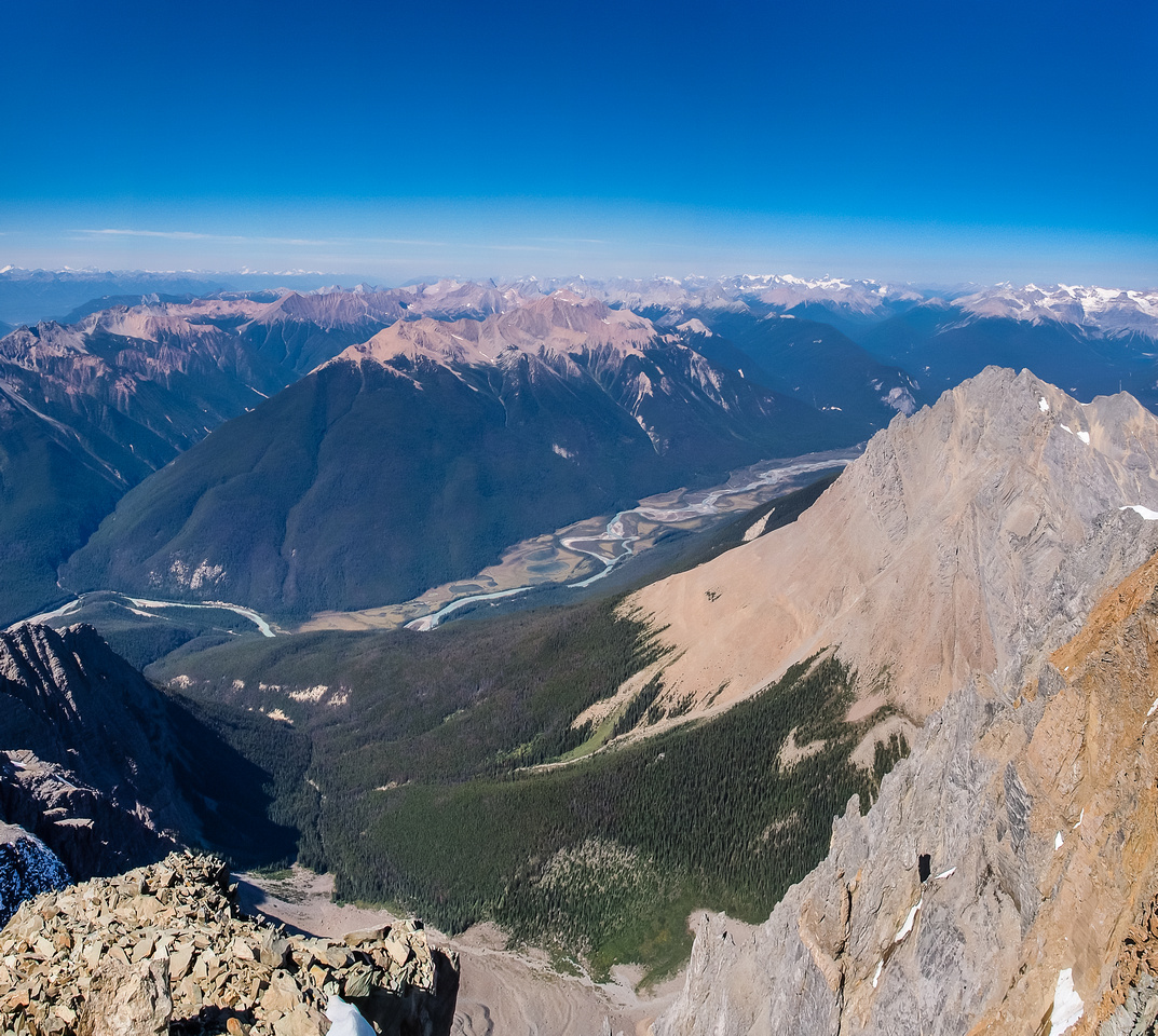That is a LONG way down! Looking 2000 meters north off the summit, down to the Kicking Horse River with Mount Hurd well below me on the right.