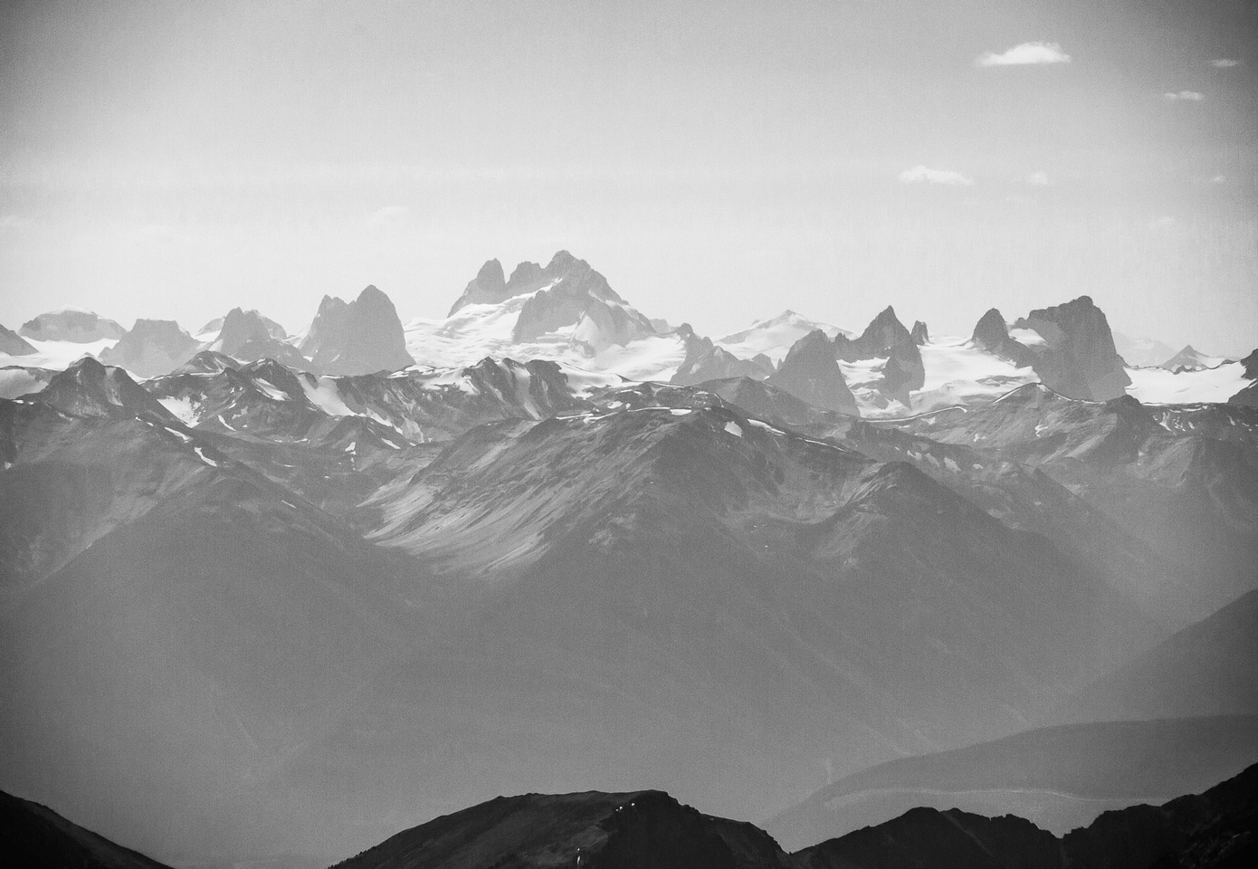 The Bugaboos are visible through haze to the west including the Howser Spires, Bugaboo Spire and Snowpatch Spire.