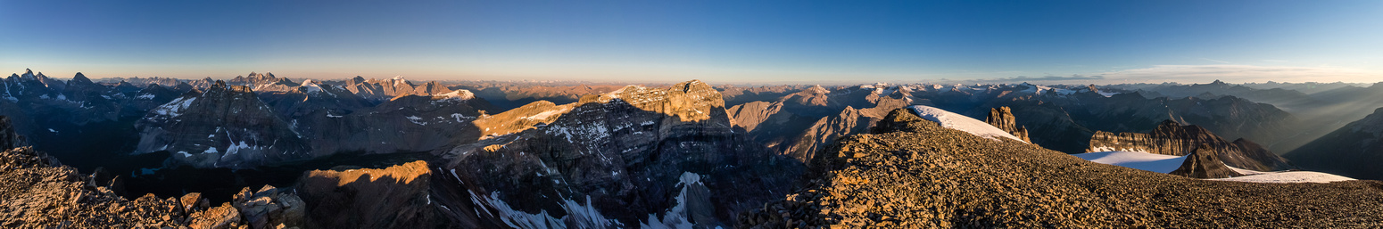 The rising sun casts shadows over many familiar peaks.