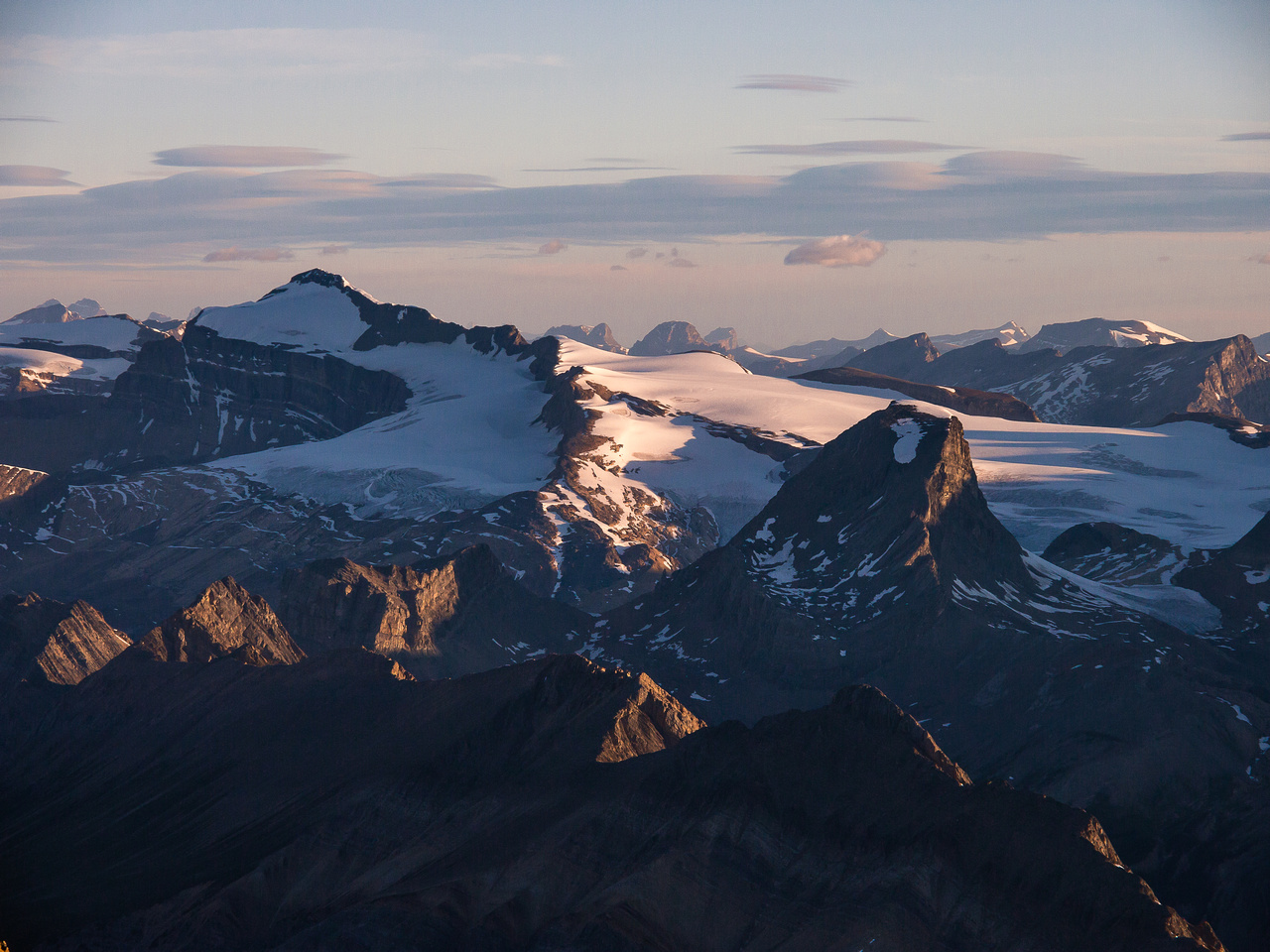 The highest peak on the Wapta Icefield, Mount Balfour, looms over Mount Niles.