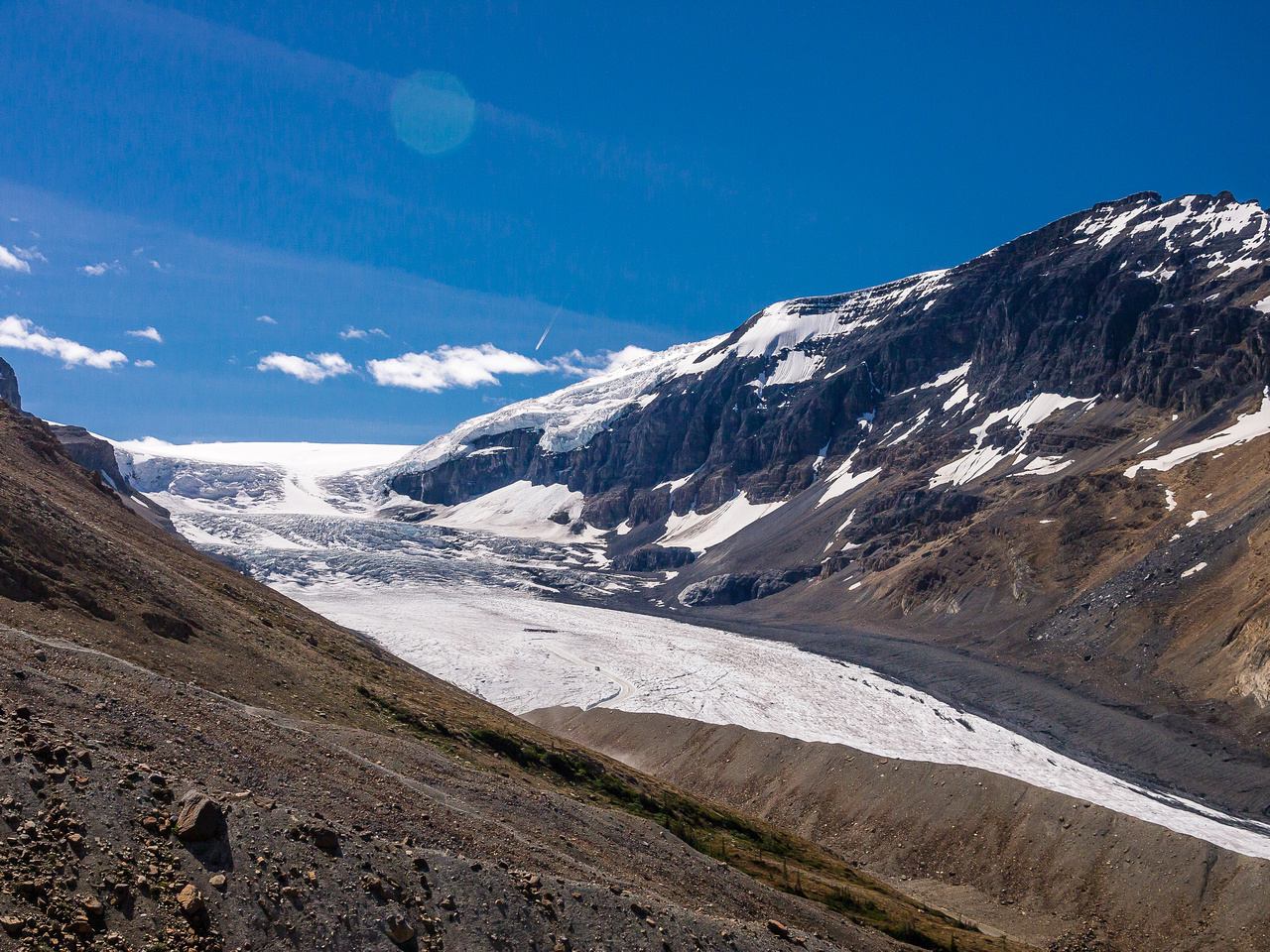 Tourists clogging the lower Athabasca Glacier, the heavy glaciated ramp and ice fall approach to the Columbia Icefields in the distance.