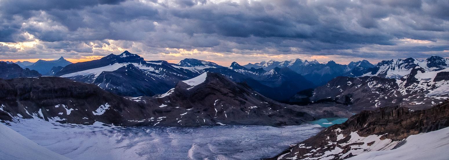 Dawn breaks over the glacier and Yoho Peak behind us.