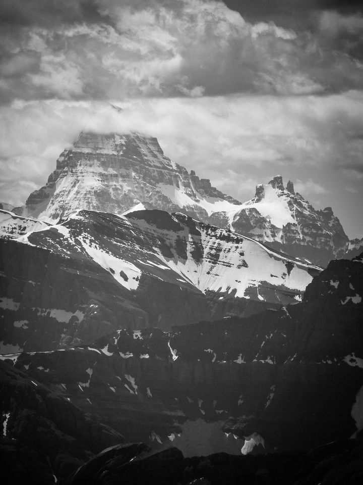 The lofty summit of Mount Assiniboine stretches skyward to the south.