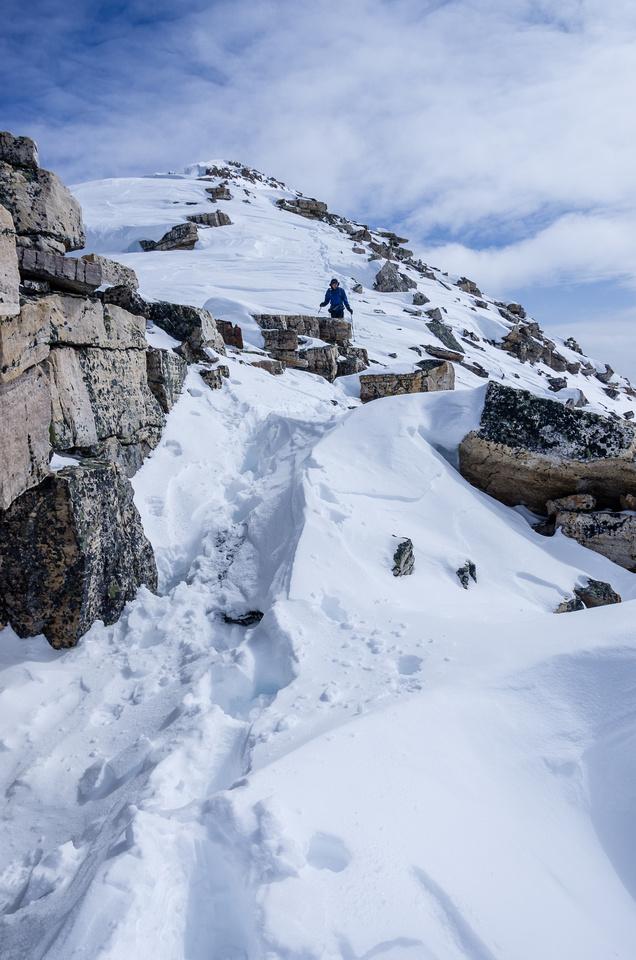 Descending the long summit ridge of Bow Peak.