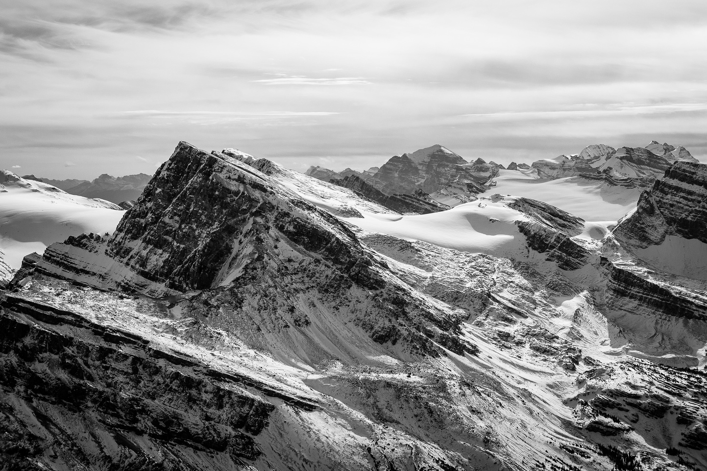 Telephoto over Crowfoot (L) and Little Crowfoot (C) towards Mount Temple.