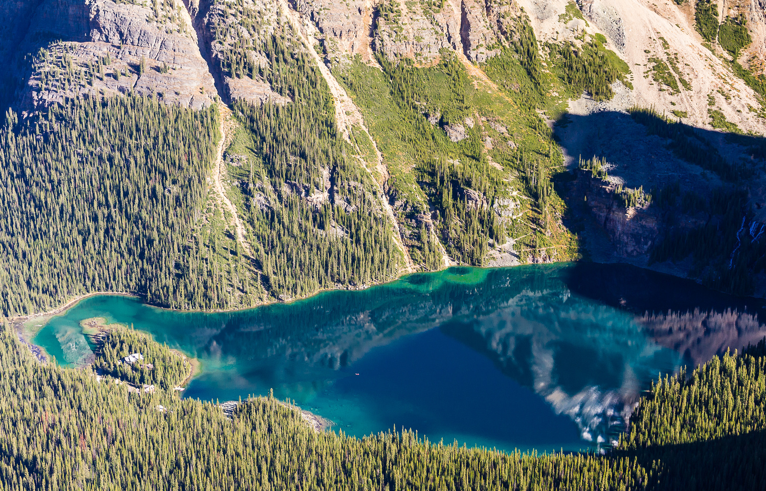 A long way down to the sublime Lake O'Hara and it's lodge. A lone kayaker barely visible on the calm lake