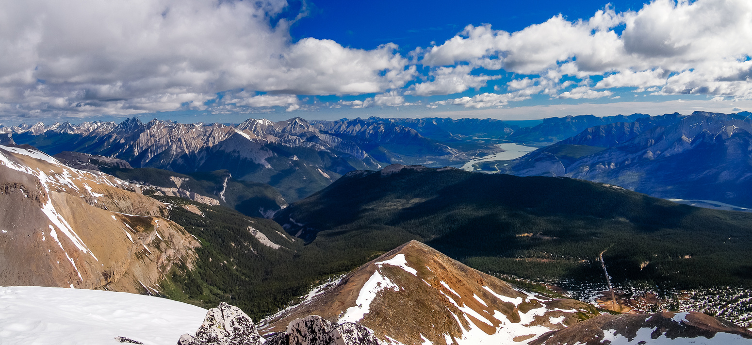 Looking down our ascent ridge with an incredible panorama opening up to the east including Maligne Lake.