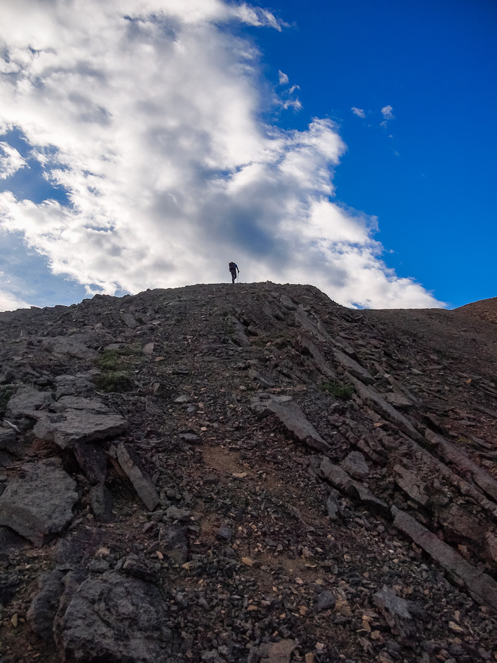 So ascends the first ridge.