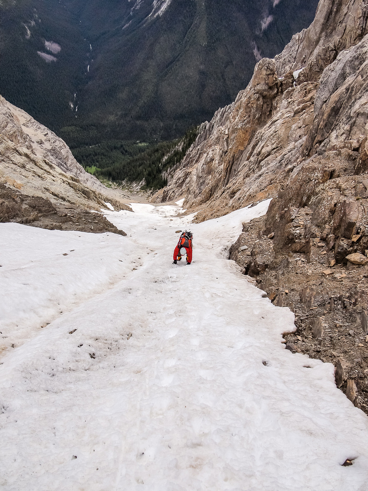 """Carefully down climbing hard avalanche debris. This was more like solid glacial ice with maybe 2-4"""" of slush on top!"""