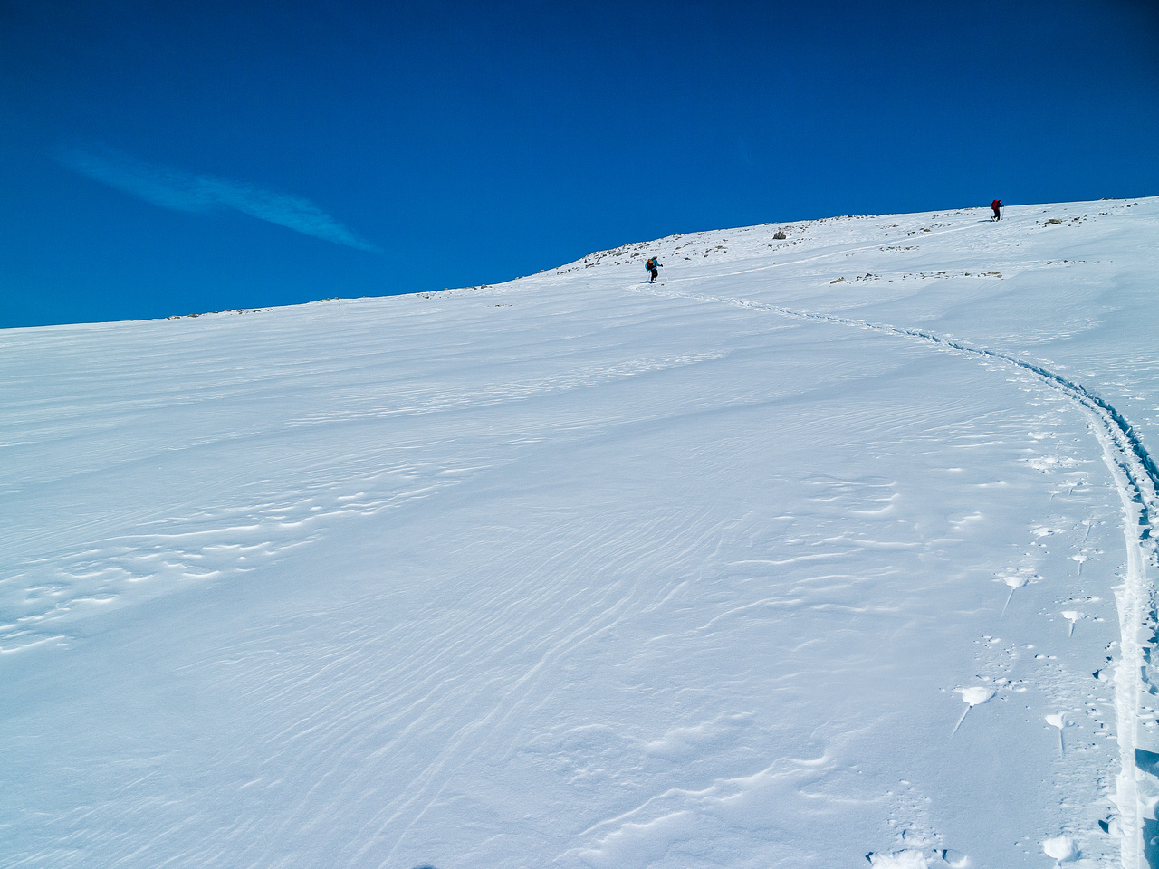 Final few meters of ascent through thin snow.